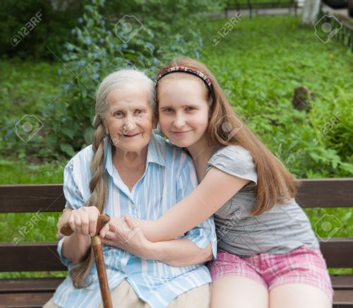 29020465-Granddaughter-hugs-grandmother-sitting-on-a-bench-in-the-garden-Stock-Photo.jpg