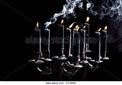 black-candles-in-candle-holder-c7jnw2