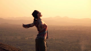 videoblocks-young-woman-enjoying-sunset-and-landscape-standing-on-hill-super-slow-motion-240fps_hr6rbvk2l_thumbnail-small08