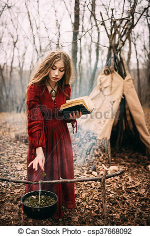 young-witch-in-the-autumn-forest-stock-photograph_csp37668092