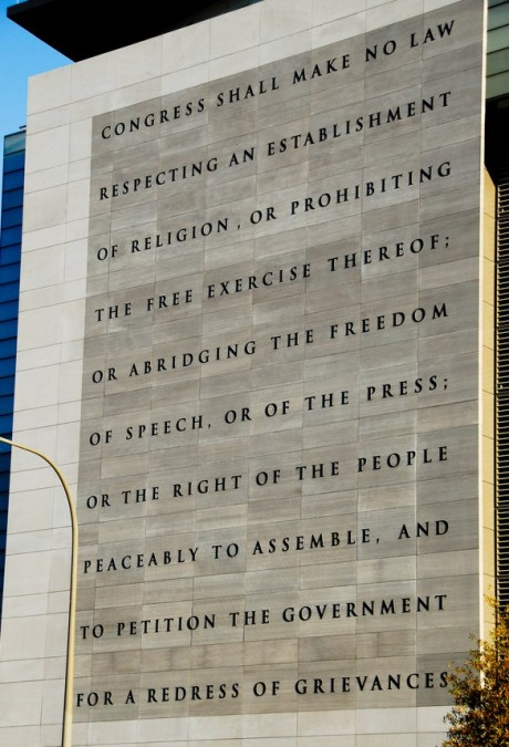 image of the exterior of the Newseum in Washington DC, into which the text of the first amendment is carved
