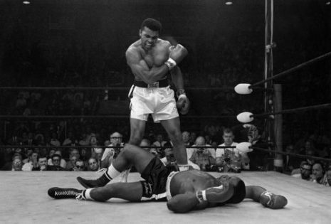 Mohamed Ali standing over Sonny Liston after knocking Liston out